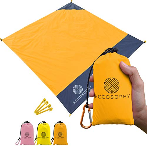 ECCOSOPHY Sand Proof Beach Blanket - 100% Waterproof Picnic Blanket 65x55 - Outdoor Compact Pocket Blanket - Lightweight Ground Cover for Hiking, Camping, Festivals, Sports, Travel- with Bag & Stakes