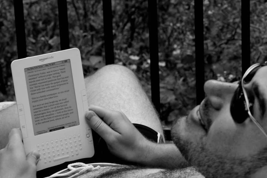 Man reading Kindle Keyboard