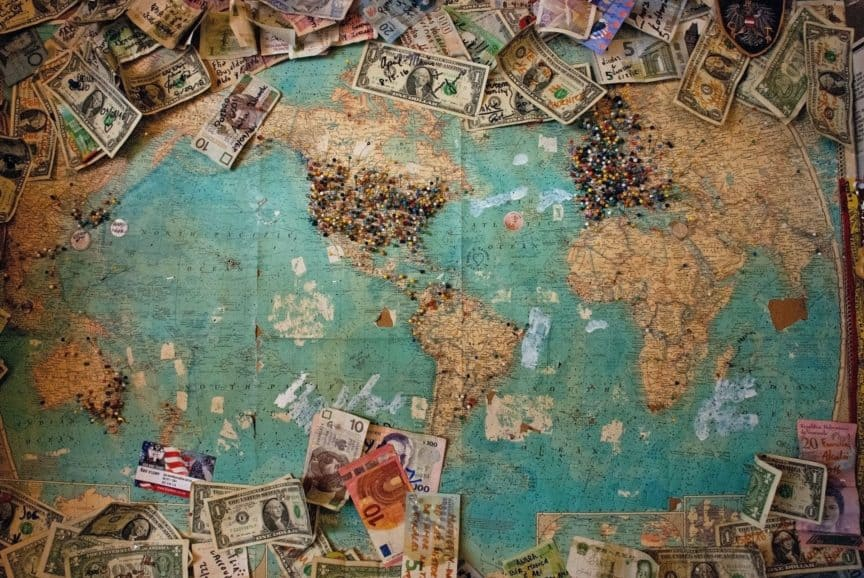 Map with pins and banknotes