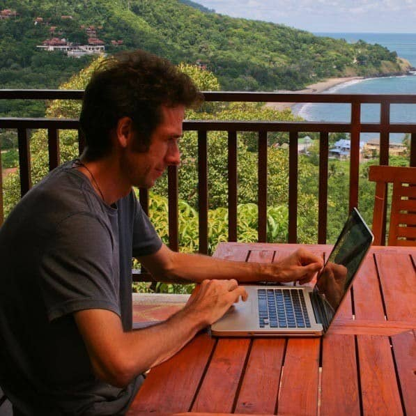 Simon on laptop, Thailand