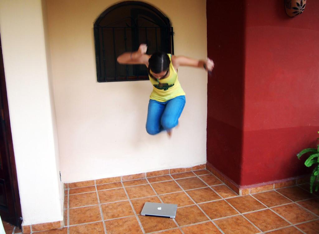 Lauren jumping on her Macbook Pro