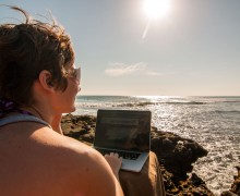 Jenny on laptop on beach