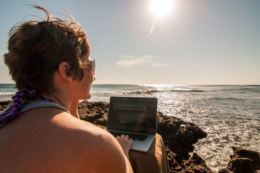 Jenny on laptop on beach
