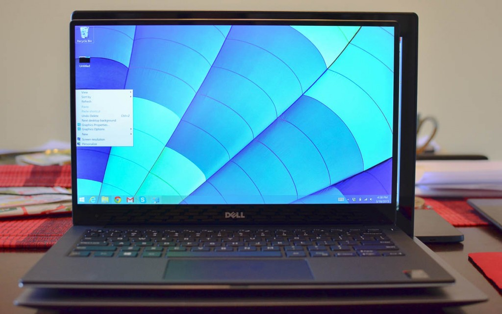 Dell XPS 13 sitting on the lap of the Asus UX302 is still shorter.