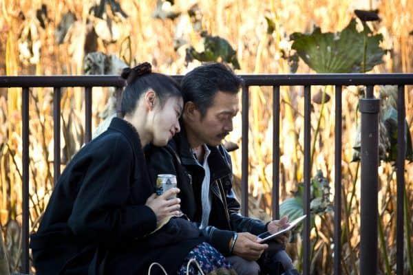 Couple on iPad in Ueno, Tokyo