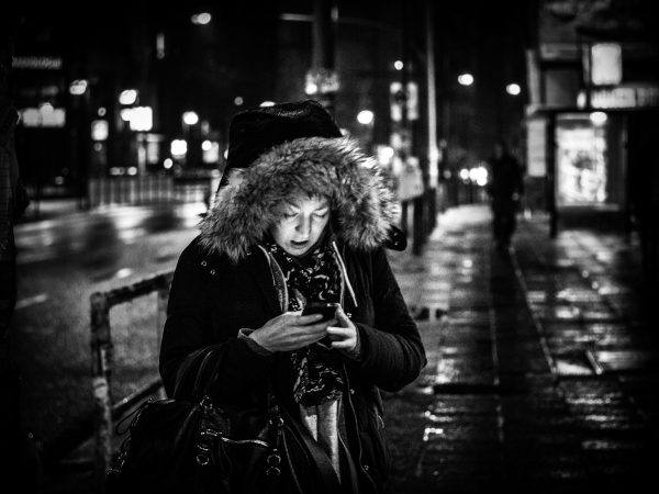 Woman with phone at night