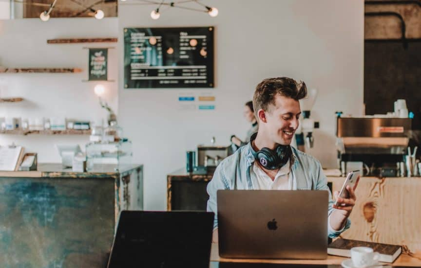 Man working in cafe with laptop