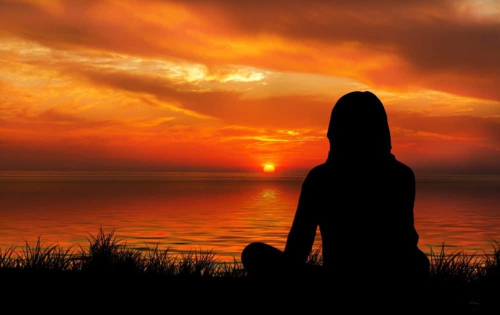 Meditating at sunset
