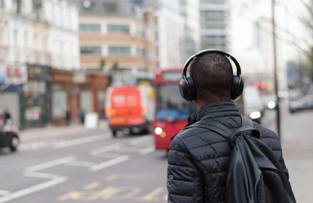 Man wearing headphones on city street