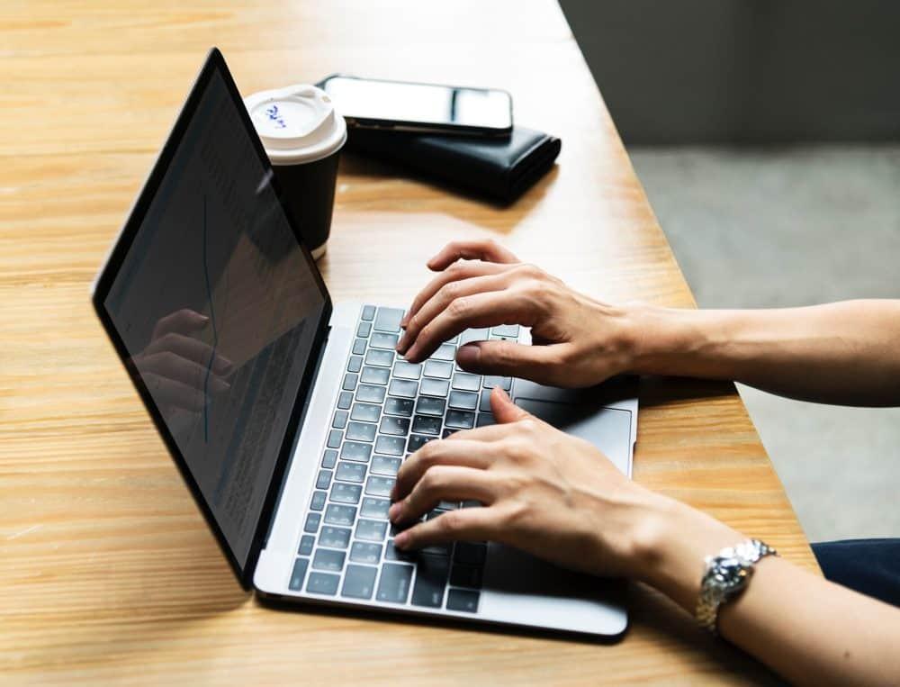 Computer, desk, and hands