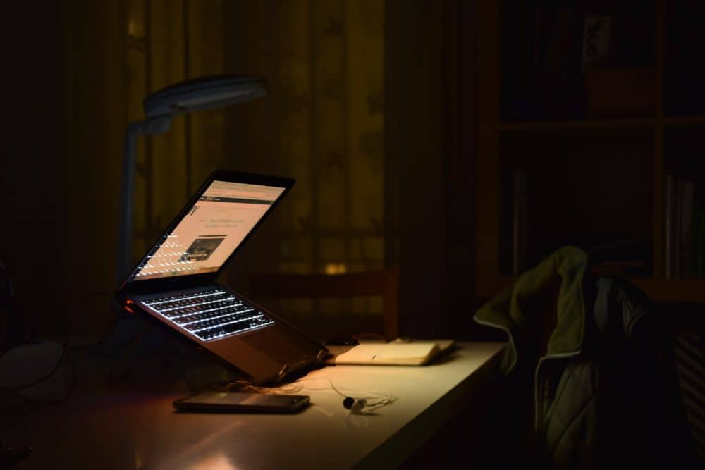 Laptop on stand at night