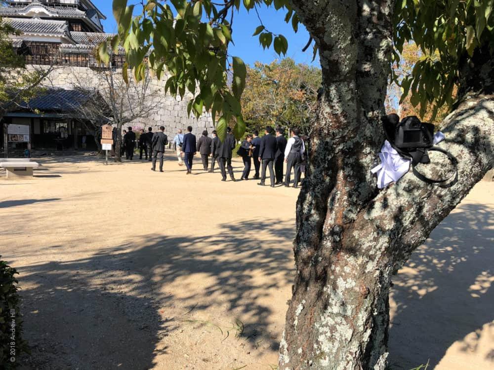 Matsuyama-camera, tree, and people