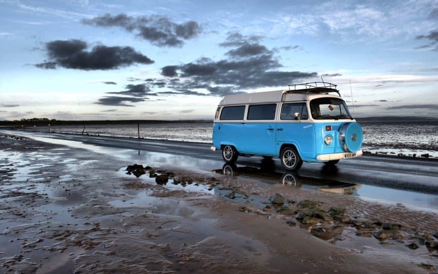 Blue campervan on beach