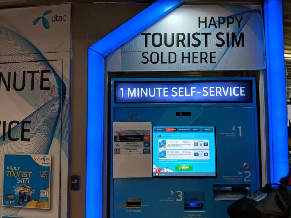 Happy self-service machine to buy a tourist SIM at Bangkok Airport in Thailand