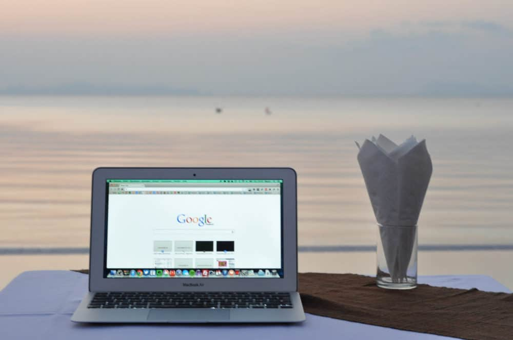 Laptop on table overlooking ocean