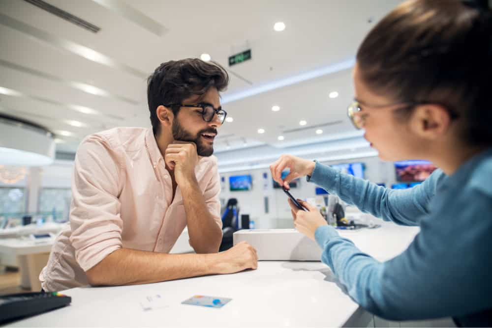 Man buying SIM card in shop