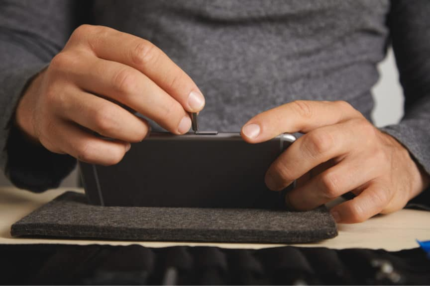 Man removing SIM card from phone