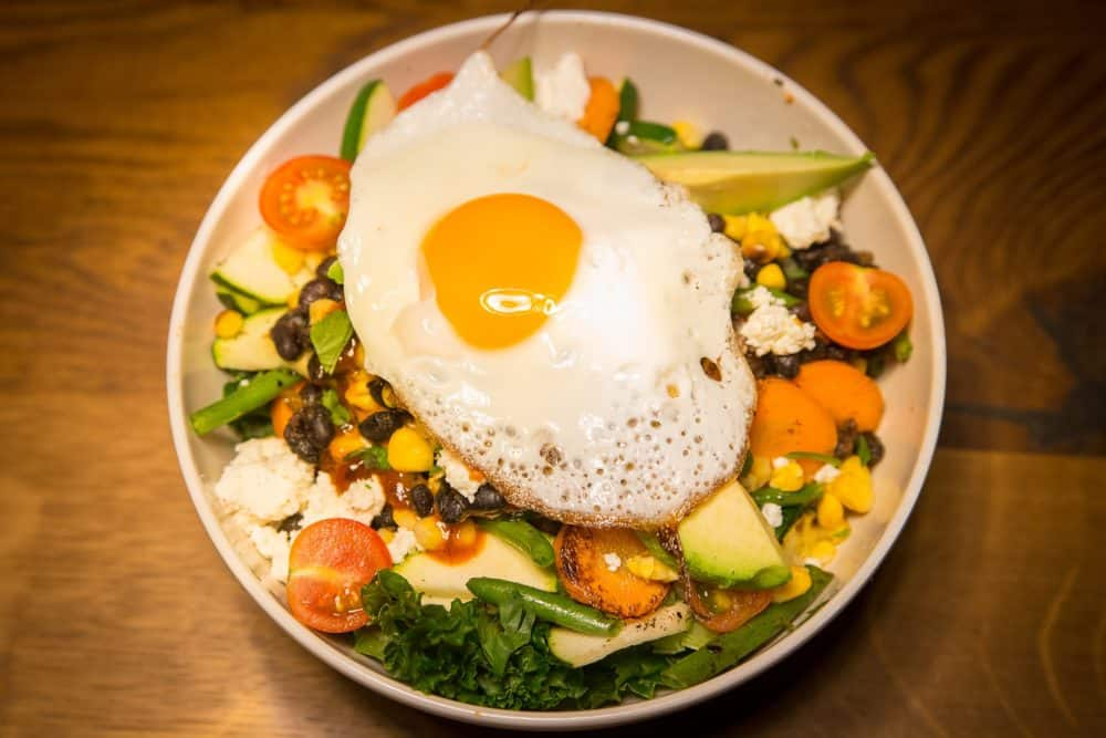Salad with fried egg