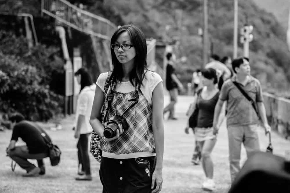 DSLR tips - woman with camera around neck