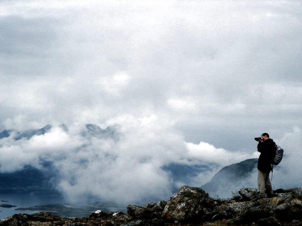 DSLR tips - Man taking photo on mountain top