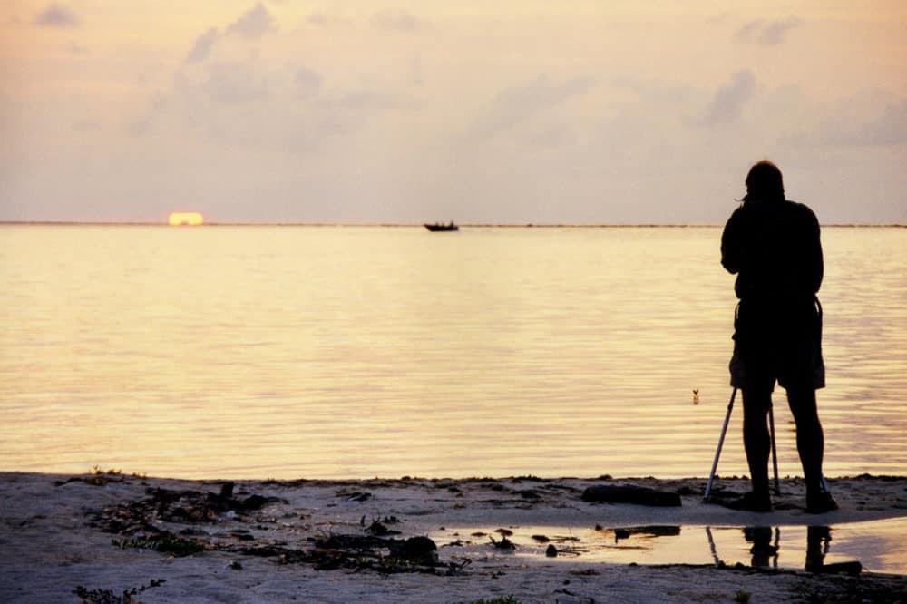 Photographer shooting on beach