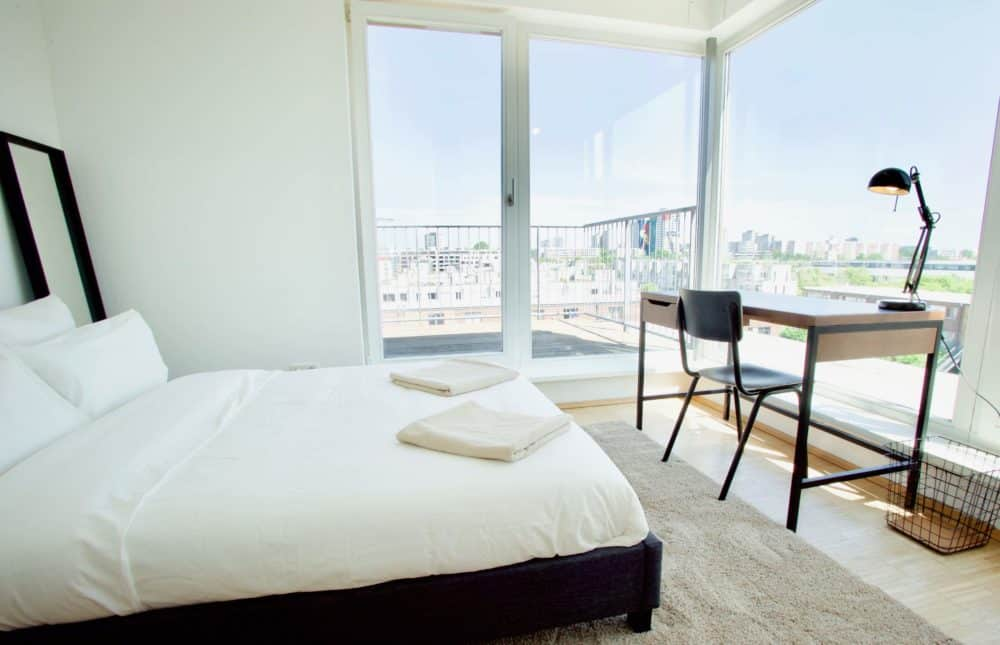 Room with bed, desk, and view