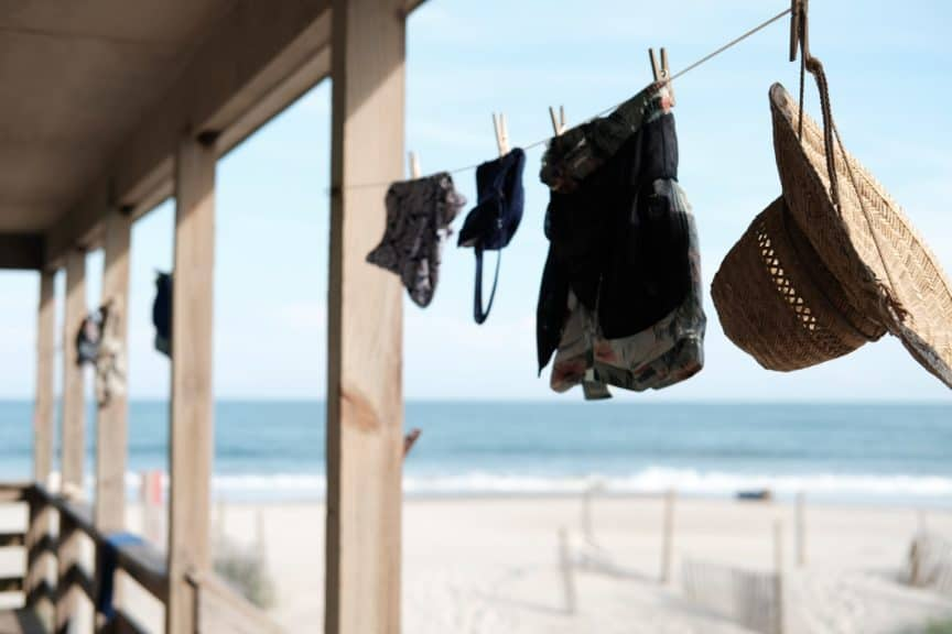 Clothes hanging on washing line near beach