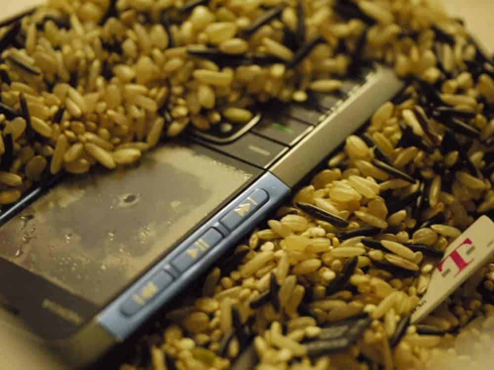 Phone sitting in rice
