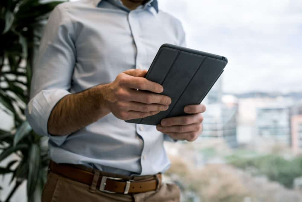 Man with iPad in case