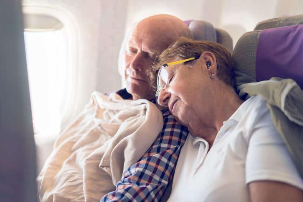 QuietOn: elderly couple on plane