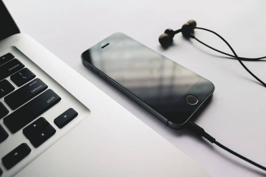 Laptop, phone, and earbuds