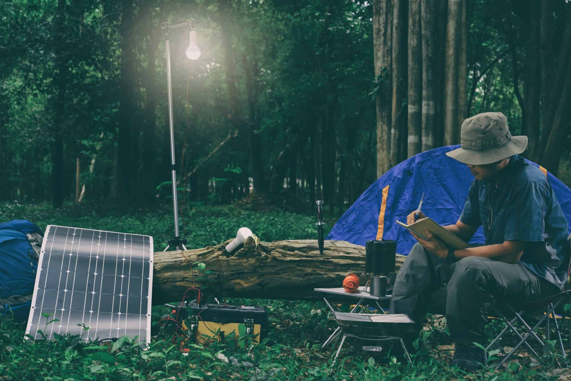 Man camping with solar panel