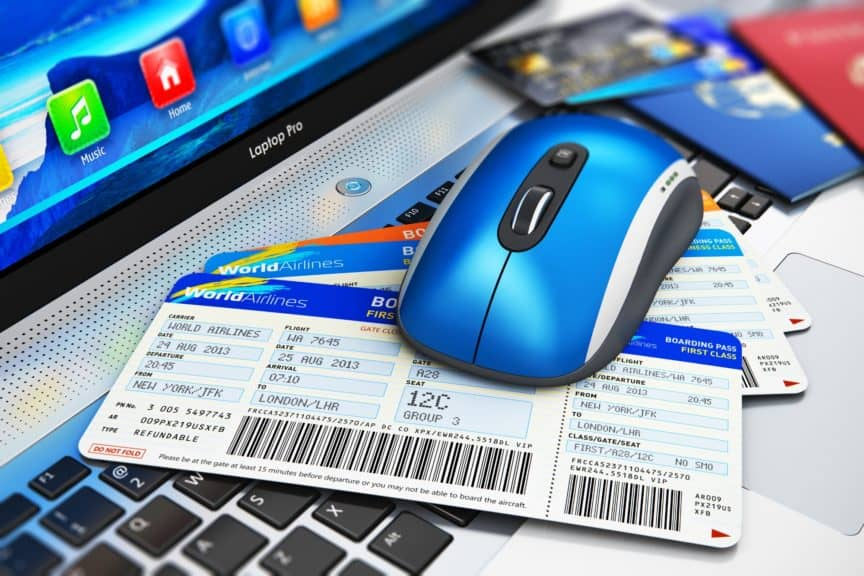 Laptop, mouse, and boarding pass