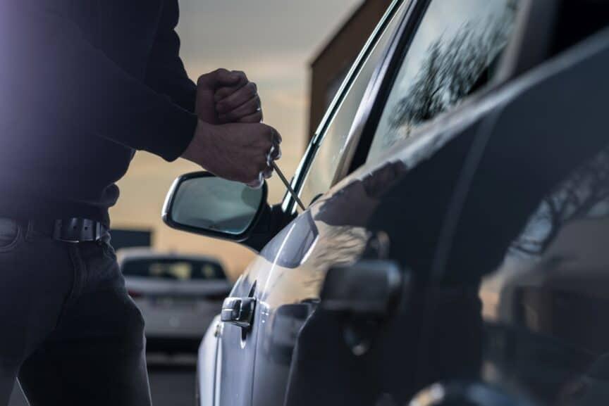 Person breaking into car