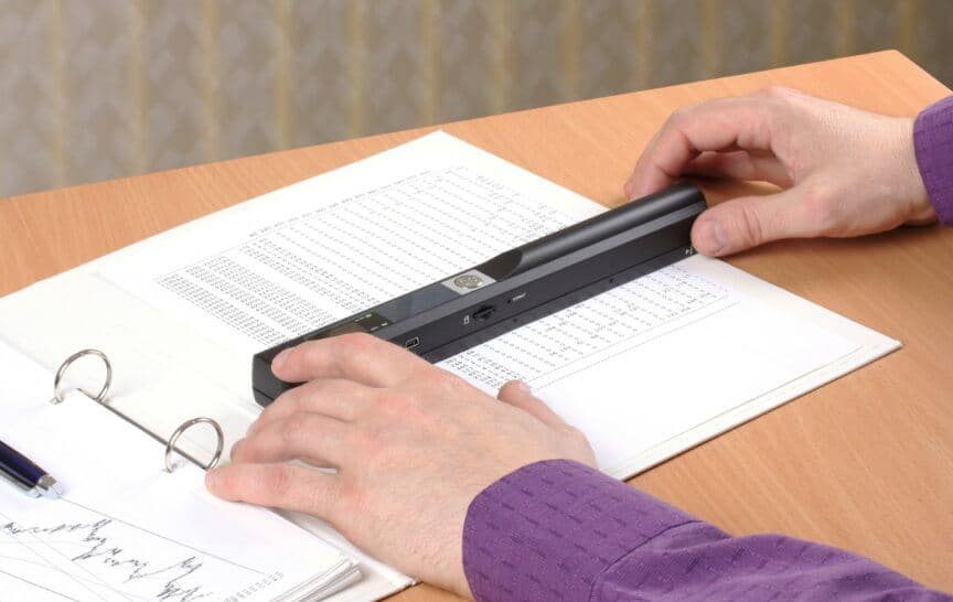 Person using portable scanner