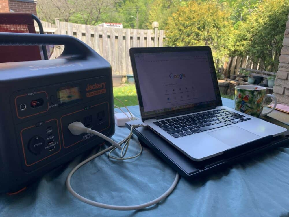 Working in backyard with laptop and Jackery portable power station