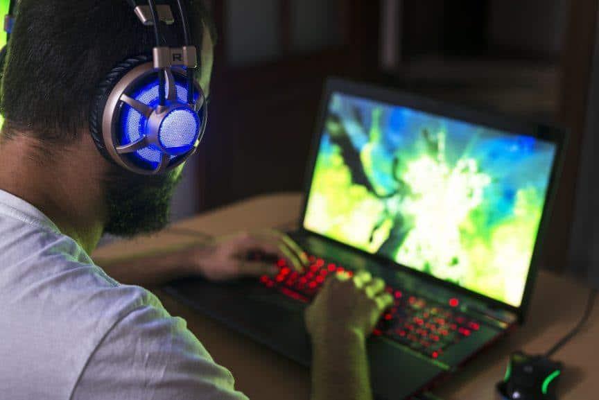 Man playing game on laptop