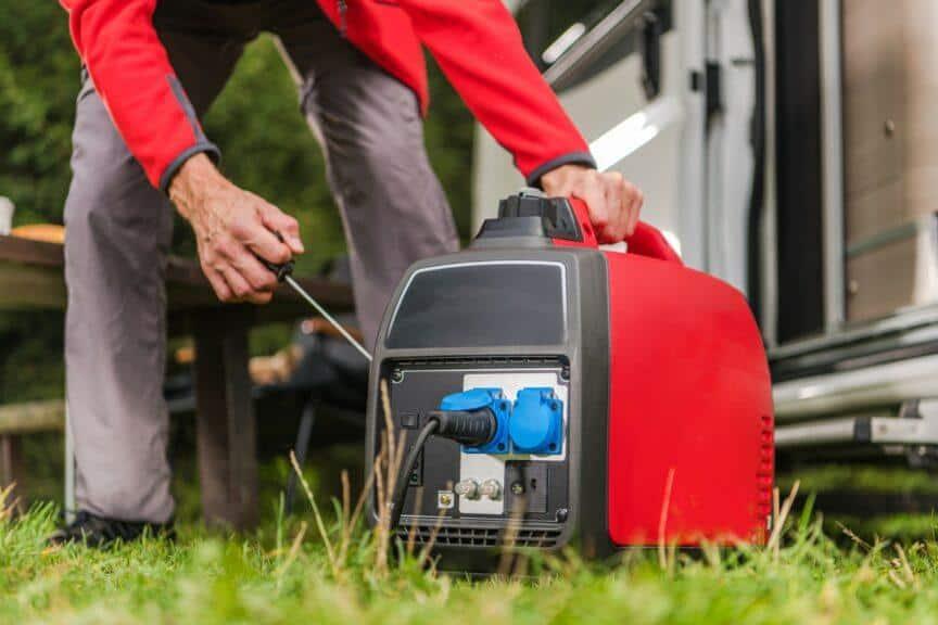 Man starting portable generator