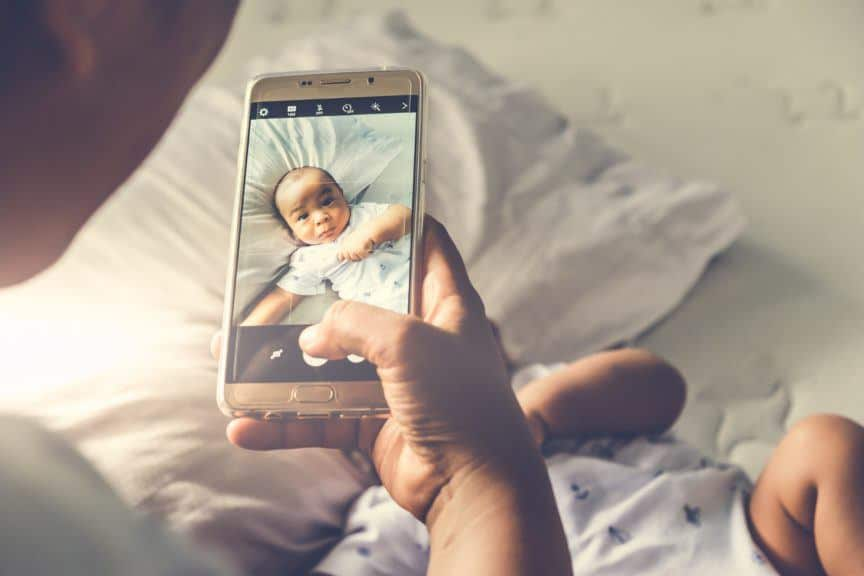 Woman taking photo of baby